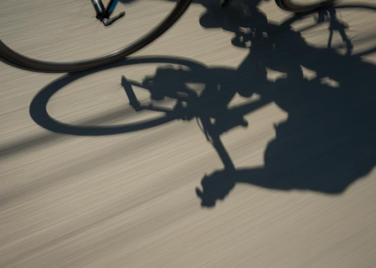 Shadow of a bike on the road